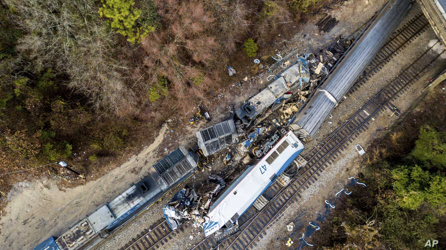 An aerial view of the site of an early morning train crash between an Amtrak train, bottom right, and a CSX freight train, top left, in Cayce, South Carolina, Feb. 4, 2018.