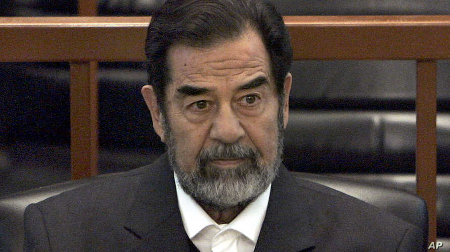 "FILE - In this Dec. 6, 2006 file photo, former Iraq leader Saddam Hussein sits in court in Baghdad, Iraq, during the ""Anfal"" trial against him."