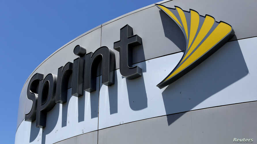 FILE - A Sprint store sign is shown in El Cajon, California, Aug. 8, 2017.