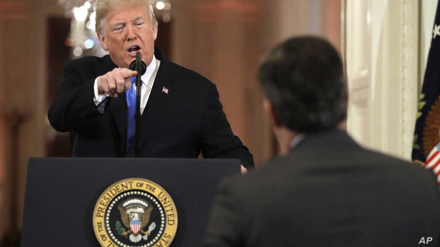 President Donald Trump points to CNN's Jim Acosta as he speaks during a news conference in the White House, in Washington, Nov. 7, 2018.