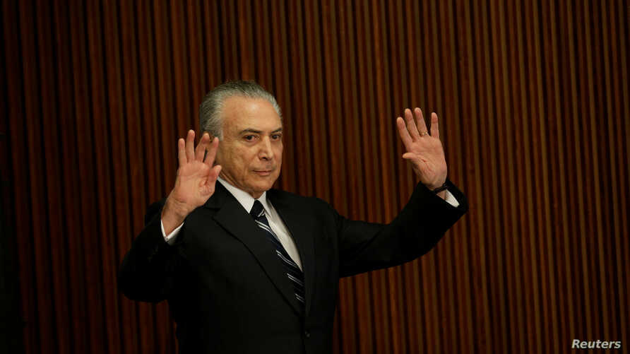 Brazil's President Michel Temer attends a meeting with the Pension Reform Commission at the Planalto Palace in Brasilia, Feb. 21, 2017.
