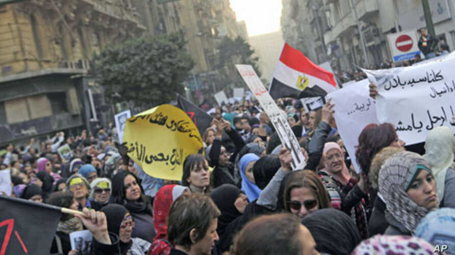 Women chant anti-military council slogans as they protest against the military council violations against female demonstrators in Cairo, Egypt, December 20, 2011.