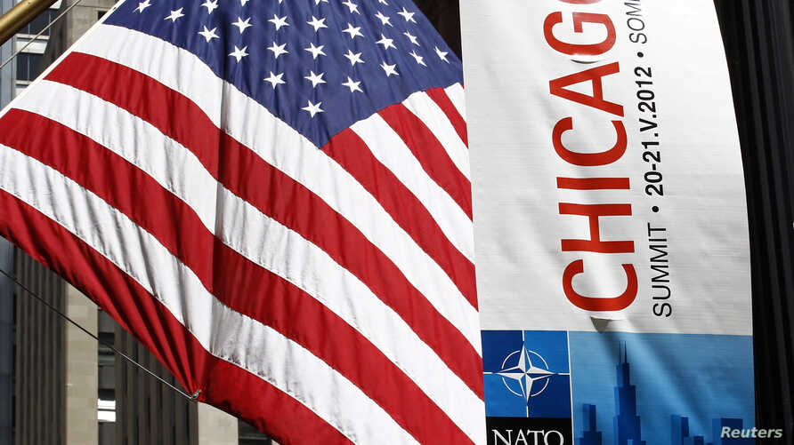 A banner is seen hanging in advance of the upcoming NATO meeting in Chicago, May 14, 2012.