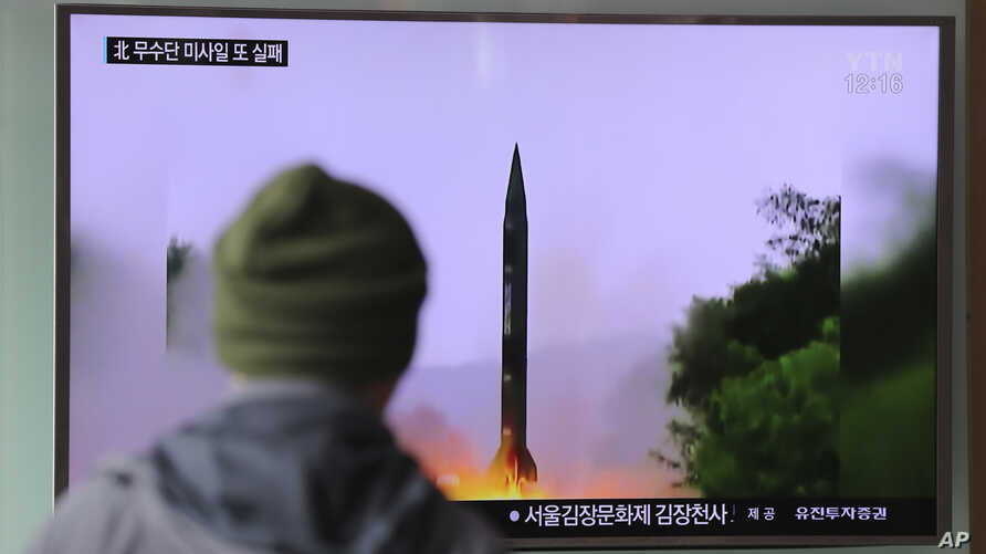 A man watches a TV news program showing a file image of missile launch conducted by North Korea, at the Seoul Railway Station in Seoul, South Korea, Oct. 20, 2016.