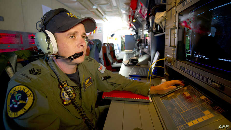 Royal Australian Air Force Airborne Electronics Analyst Flight Sergeant Tom Stewart from 10 Squadron watching a radar screen for signs of debris on board an AP-3C Orion over the Southern Indian Ocean during the search for missing Malaysian Airlines f