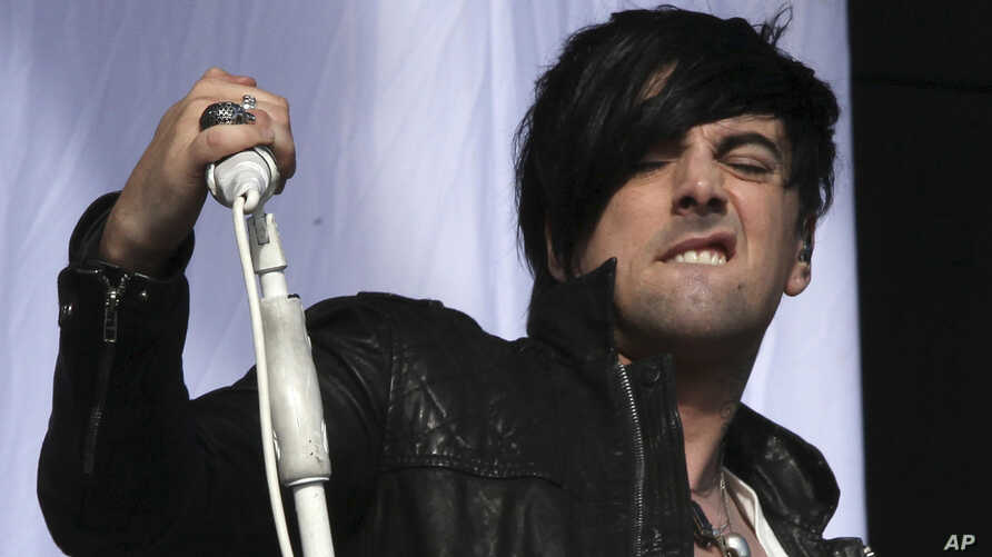 FILE - British musician Ian Watkins, lead singer of Lostprophets performs on stage at V Music Festival in Hylands Park, Chelmsford, England, Aug 20, 2011