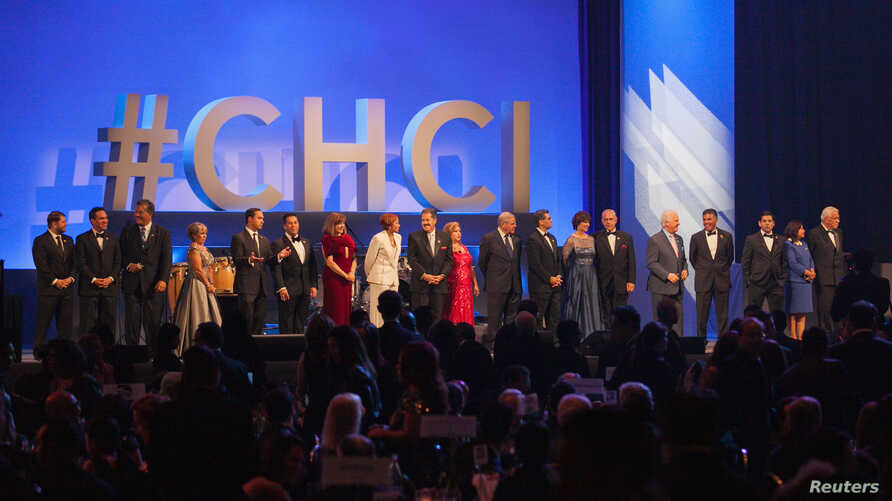 FILE - Members of the Congressional Hispanic Caucus Institute are seen on stage at CHCI's 38th Awards Gala at The Walter E. Washington Convention Center Washington, D.C., Oct, 8, 2015.