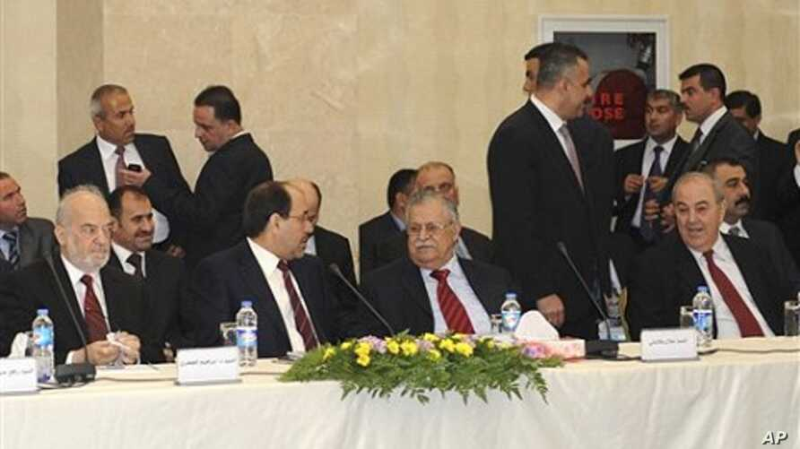 Leaders of Iraq's main political blocs, front row, from left to right: former Iraqi Prime Minister Ibrahim Jafari, Iraqi Prime Minister Nouri al-Maliki, Iraqi President Jalal Talabani and former Iraqi Prime Minister Ayad Allawi, are seen during their