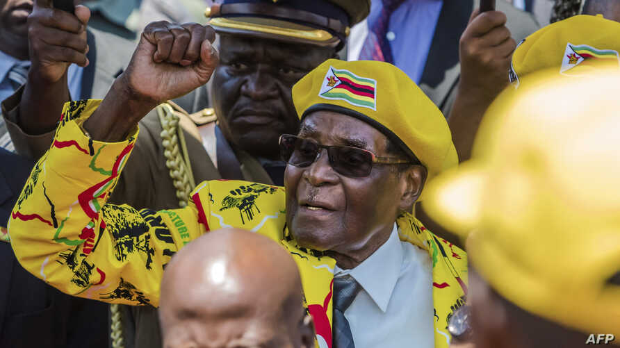 File photo taken on Nov. 8, 2017, shows Zimbabwe's President Robert Mugabe greeting party members and supporters gathered at his party headquarters.