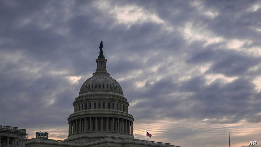 The Capitol is seen in Washington, Friday morning, Dec. 14, 2018, after Congress adjourned until next week. Congress is racing to avoid a partial government shutdown over President Donald Trump's border.