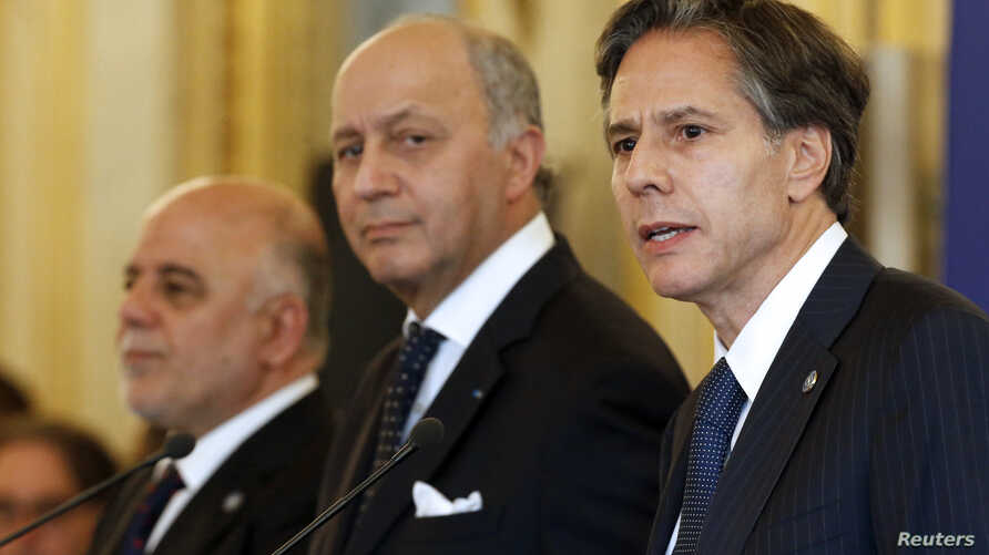 From L-R, Iraqi Prime Minister Haider al-Abadi, French Foreign Affairs Minister Laurent Fabius and U.S. Deputy Secretary of State Antony Blinken hold a news conference following a meeting with members of the anti-Islamic State coalition in Paris, Fra