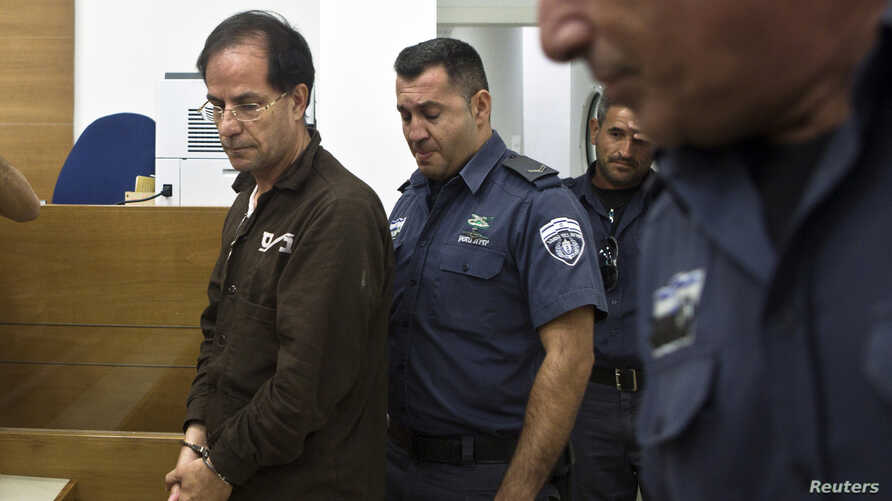 Iranian-Belgian citizen Ali Mansouri is seen arriving at a courtroom at the magistrate's court in Petah Tikva near Tel Aviv September 30, 2013.