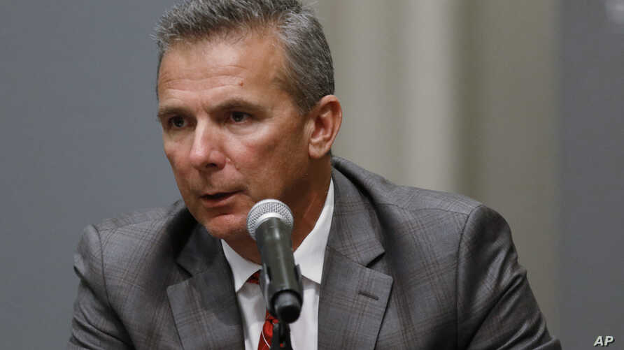 Ohio State football coach Urban Meyer makes a statement during a news conference in Columbus, Ohio, Aug. 22, 2018. Ohio State suspended Meyer on Wednesday for three games for mishandling domestic violence accusations, punishing one of the sport's mos