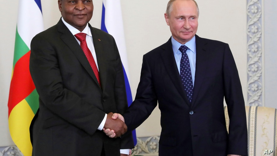 Russian President Vladimir Putin, right, shakes hands with Central African Republic President Faustin-Archange Touadera, in St. Petersburg, Russia, Wednesday, May 23, 2018.