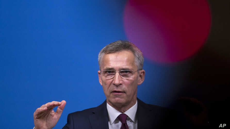 NATO Secretary General Jens Stoltenberg talks to journalists during a news conference at NATO headquarters in Brussels, Belgium, Oct. 24, 2018