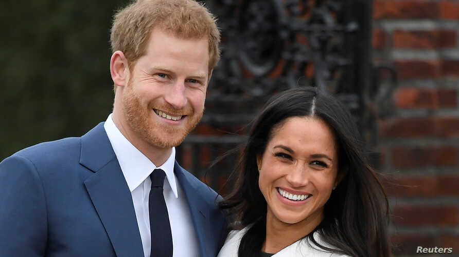 Britain's Prince Harry poses with Meghan Markle in the Sunken Garden of Kensington Palace, London, Britain, Nov. 27, 2017.