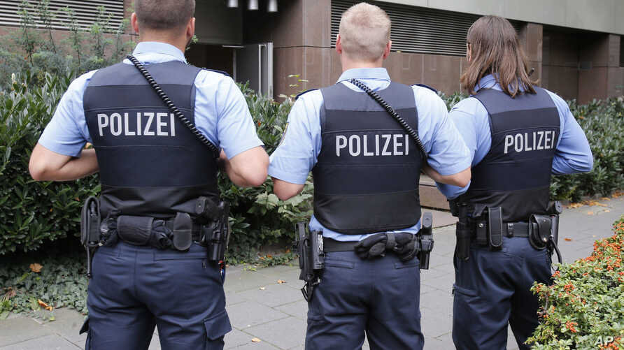 German police officers guard outside the regional court in Frankfurt, Germany, Monday, Sept.15, 2014.