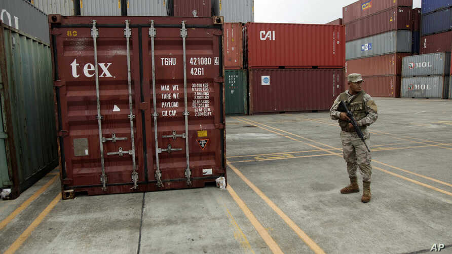 A police officer stands guard aboard the North Korean-flagged freighter Chong Chon Gang, at the Manzanillo International container terminal on the coast of Colon City, Panama, Wednesday, July 17, 2013. North Korea on Wednesday repeated Cuba's asserti