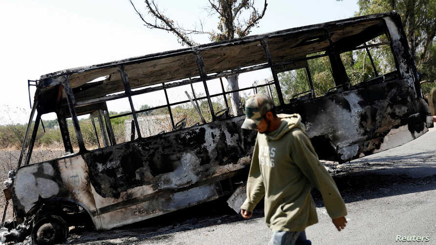 The wreckage of a bus that was burnt in a blockade set by members of the Santa Rosa de Lima Cartel to repel security forces during an anti-fuel theft operation is pictured in Santa Rosa de Lima, in Guanajuato state, Mexico, March 6, 2019.