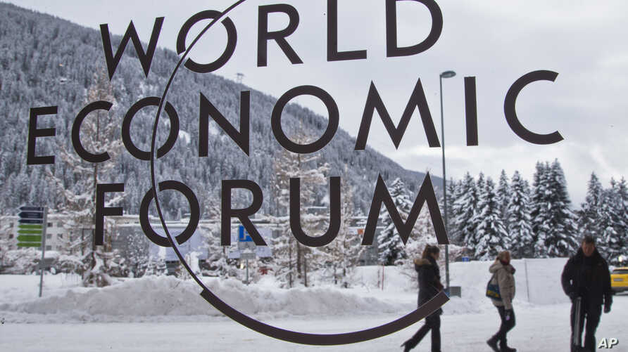 The logo of the World Economic Forum is  visible through a window at the congress center where the annual meeting will take place in Davos, Switzerland, Jan. 15, 2017.
