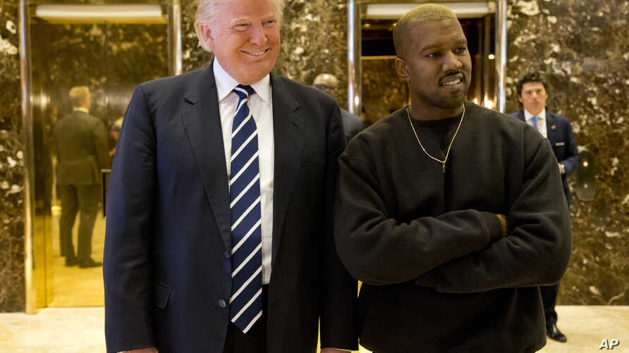 President-elect Donald Trump and Kanye West are pictured in the lobby of Trump Tower in New York, Dec. 13, 2016.