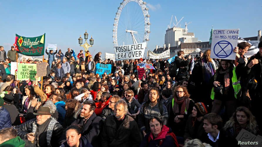 Environmental campaigners from the direct action group Rebellion demonstrate on Westminster Bridge in central London, Britain, November 17, 2018.