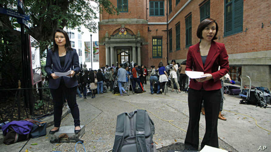 Reporters gather outside the Court of Final Appeal in Hong Kong, March 25, 2013.