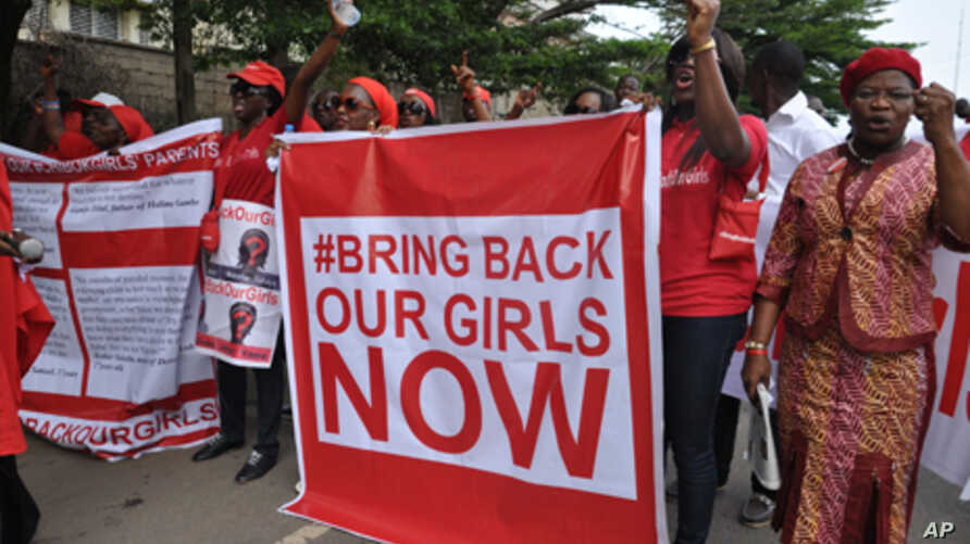 """Scores of protesters marched chanting """"Bring Back Our Girls"""" kidnapped six months ago by Boko Haram."""
