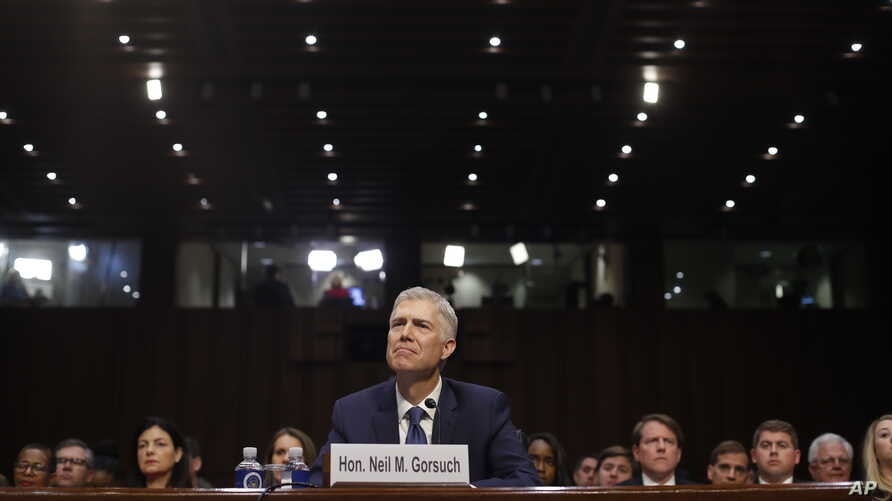 Supreme Court Justice nominee Neil Gorsuch arrives for his confirmation hearing before the Senate Judiciary Committee on Capitol Hill in Washington, March 20, 2017.