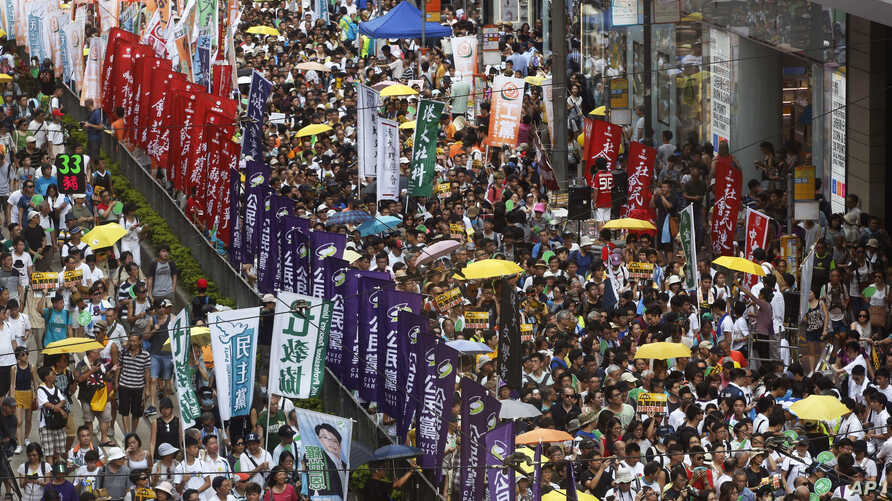 Pro-democracy protesters march during an annual protest marking Hong Kong's handover from British to Chinese rule in 1997 in Hong Kong, Wednesday, July 1, 2015.