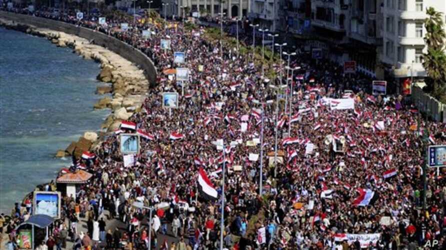 Tens of thousands of Egyptian anti-government protesters celebrate in Alexandria, Egypt, February 11, 2011