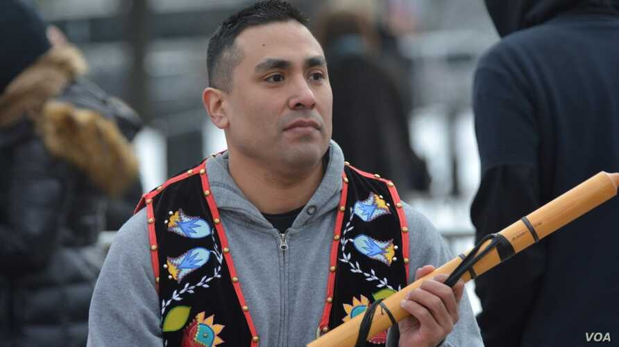 Ojibwe flutist Darren Thompson at the Indigenous Peoples March in Washington, D.C., Jan. 18, 2019.  Photo by Mike Garcia.
