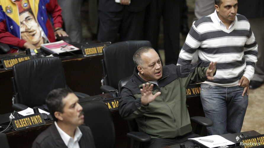 Diosdado Cabello (C), deputy of Venezuela's United Socialist Party (PSUV), gestures during a session of the National Assembly in Caracas, Jan. 13, 2016.