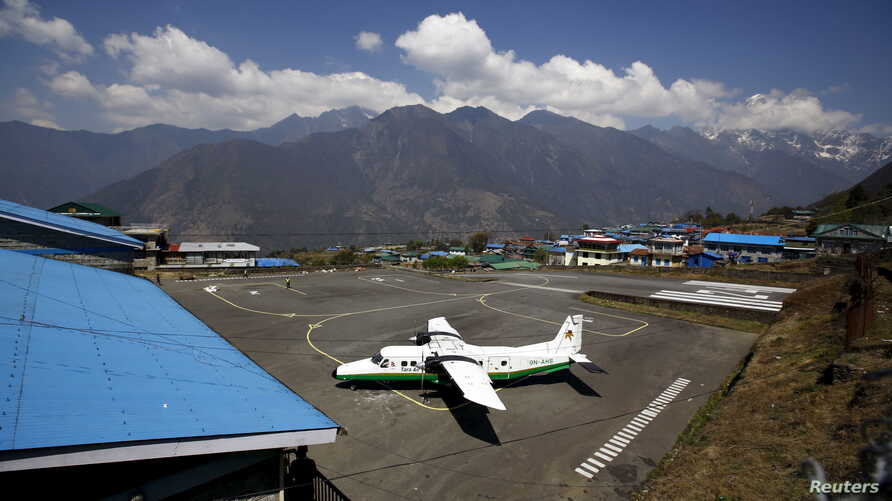 FILE - A Twin Otter aircraft belonging to Tara Air is pictured at Tenzing Hillary Airport, in Lukla, approximately 2800 meters above sea level, in Solukhumbu district, Nepal.