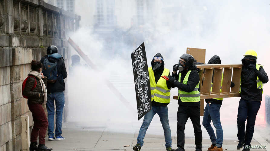 Protesters attend a demonstration of the yellow vest movement in Nantes, France, Jan. 12, 2019.
