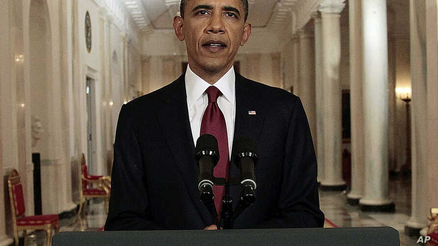 President Barack Obama reads a statement on the death of Osama bin Laden from the East Room of the White House in Washington, May 1, 2011.  (AP)