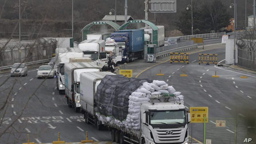 South Korean vehicles returning from North Korea's joint Kaesong Industrial Complex pass the customs, immigration and quarantine office near the border village of Panmunjom, in Paju, South Korea, Feb. 11, 2016.