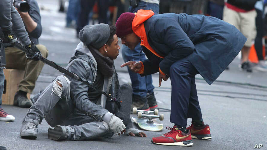 """Will Smith, right, films a scene in """"Collateral Beauty,"""" set in New York City, March 31, 2016."""