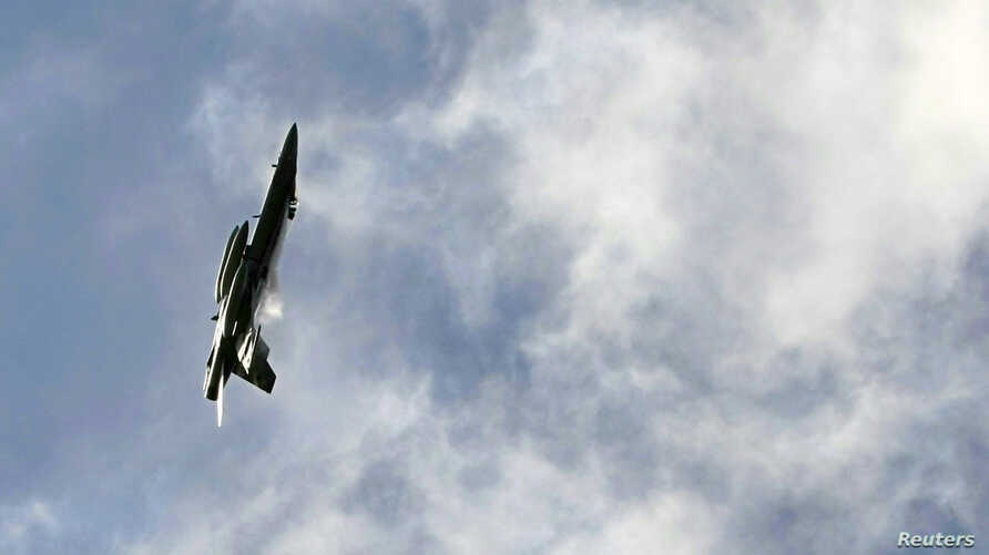 FILE - An Australian FA-18 fighter aircraft circles over Sydney.