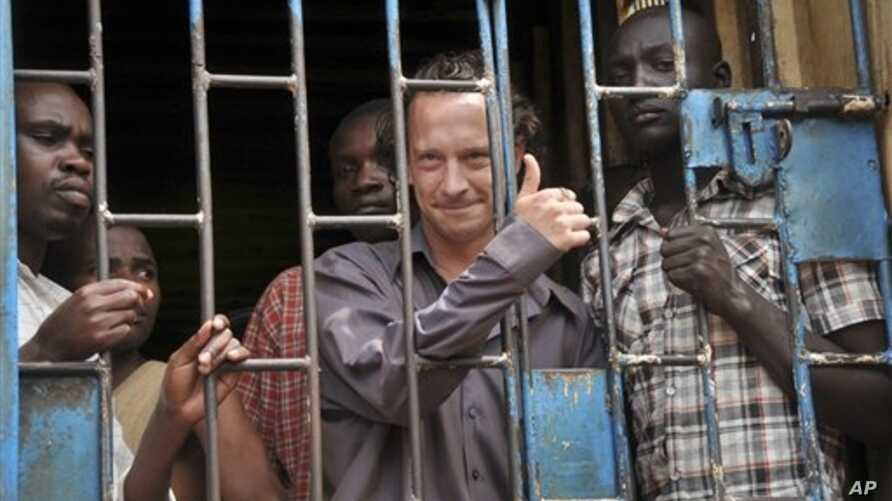 David Cecil, British producer of a play concerning the condition of Uganda's gays, in a courtroom cell, Kampala, Sept. 13, 2012.