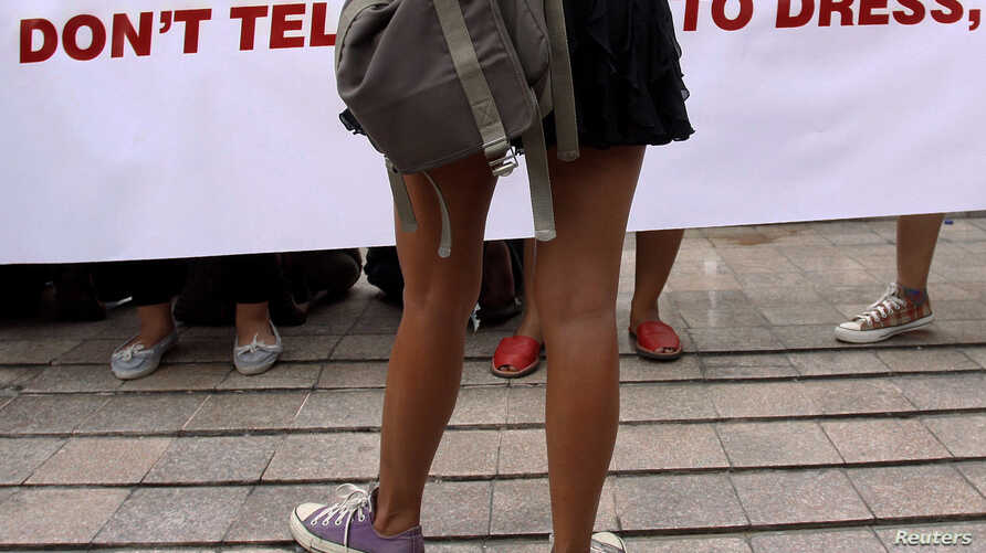 FILE - A woman wearing a miniskirt takes part in a protest against the idea that provocatively dressed women are to blame for sexual assaults.