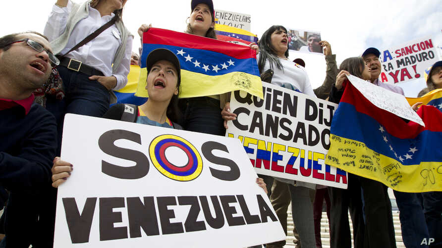 FILE - Demonstrators who are against the Venezuelan government chant outside of the Organization of American States during the special meeting of the Permanent Council, in Washington, April 3, 2017, to consider the recent events in Venezuela.