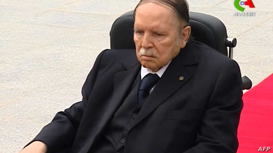 """FILE - A picture from video footage broadcast by Algeria's """"Canal Algerie"""" on July 5, 2016 shows wheelchair-bound President Abdelaziz Bouteflika visiting El-Alia cemetery where independence fighters are buried in an eastern Algiers suburb."""