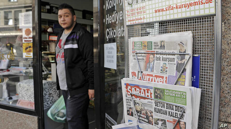 FILE - Turkish newspapers are sold in front of a shop at the Turkish neighborhood in Duisburg-Marxloh, Germany, Monday, Oct. 31, 2011.