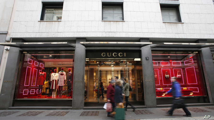 Italy Luxury Goods-Sales: People walk in front of Gucci shop in Monte Napoleone street in Milan, Italy, Thursday, Oct. 20, 2016. The terror threat in Europe, a strong dollar and uncertainty over the U.S. presidential elections have eroded the confide