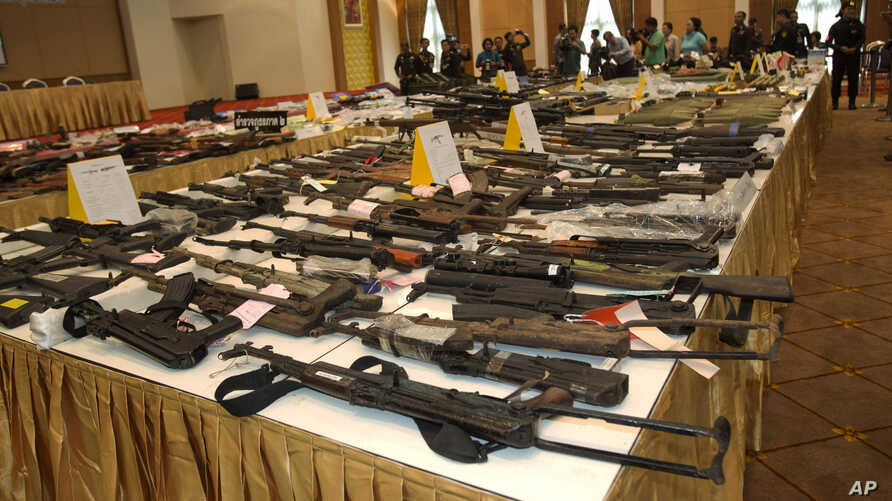 Weapons Thai military seized from raids from May 22 to June 25 are displayed during a news conference in Bangkok, Thailand, Sunday, June 29, 2014.
