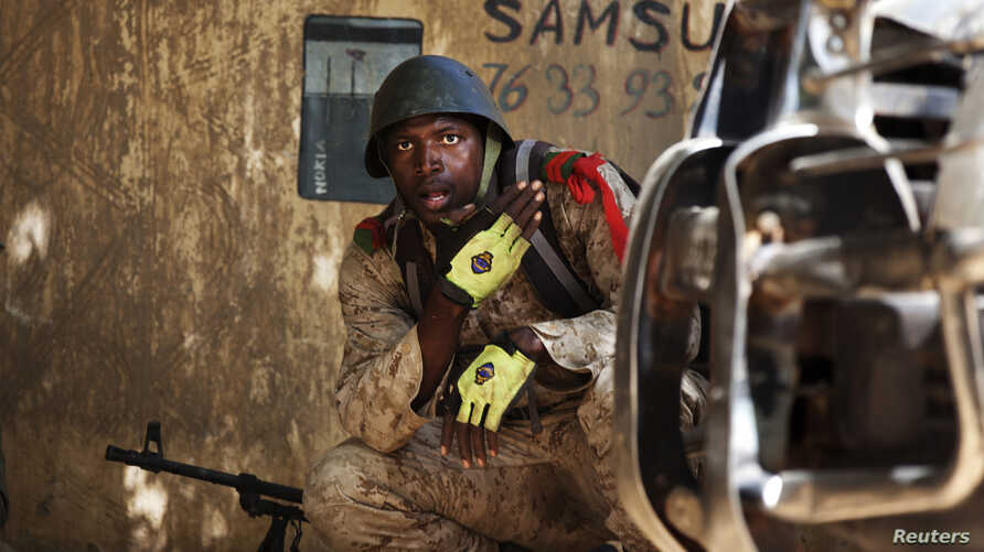 A Malian soldier looks on during fighting with Islamists in Gao, February 21, 2013.