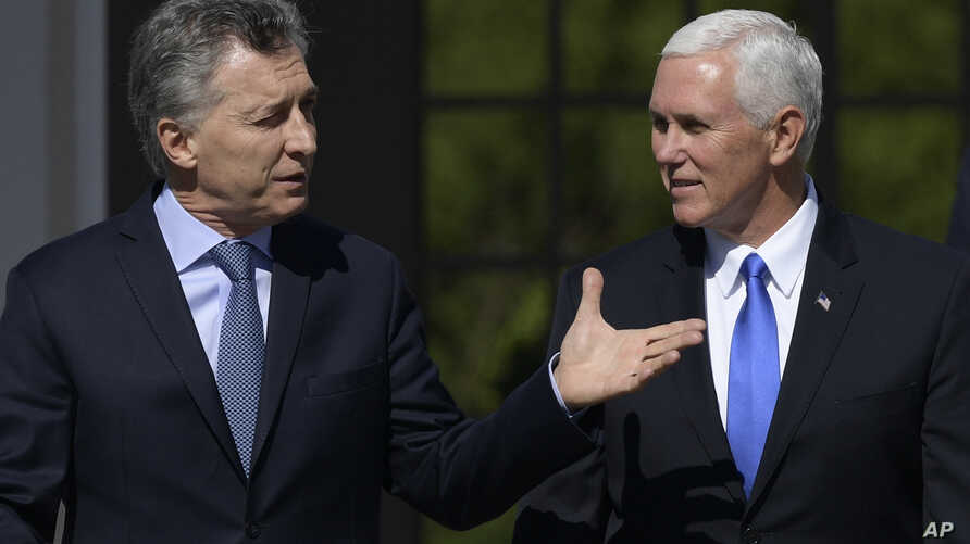 U.S. Vice President Mike Pence, right, walks with Argentina's President Mauricio Macri at the government residence in Buenos Aires, Argentina, Aug. 15, 2017.