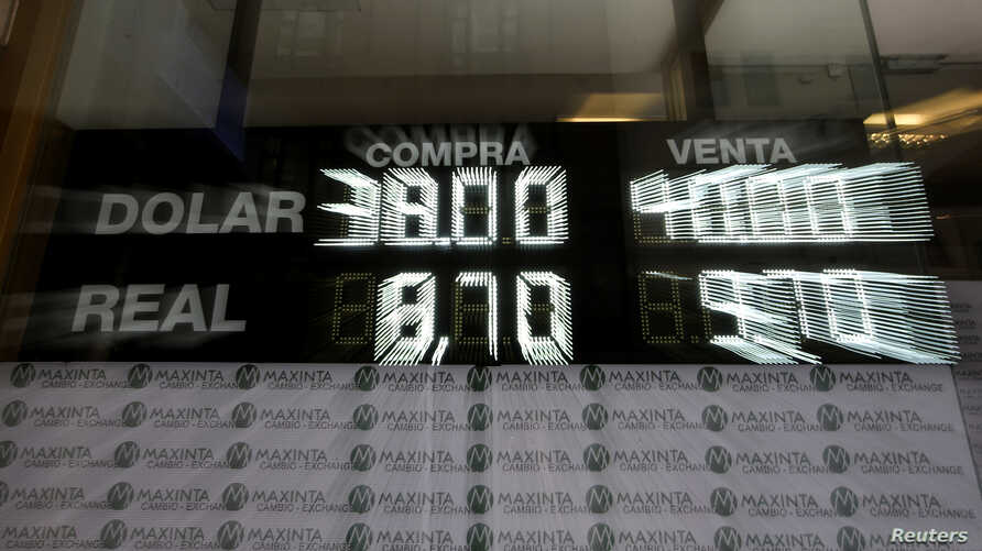 An electronic board shows currency exchange rates, in Buenos Aires' financial district in Argentina, Sept. 4, 2018.