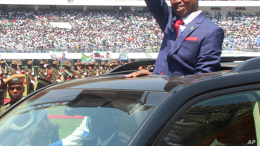 Zambia President Inaugurated: President Edgar Lungu of Zambia, waves to the crowd during his inauguration in Lusaka, Zambia, Tuesday, Sept. 13, 2016.